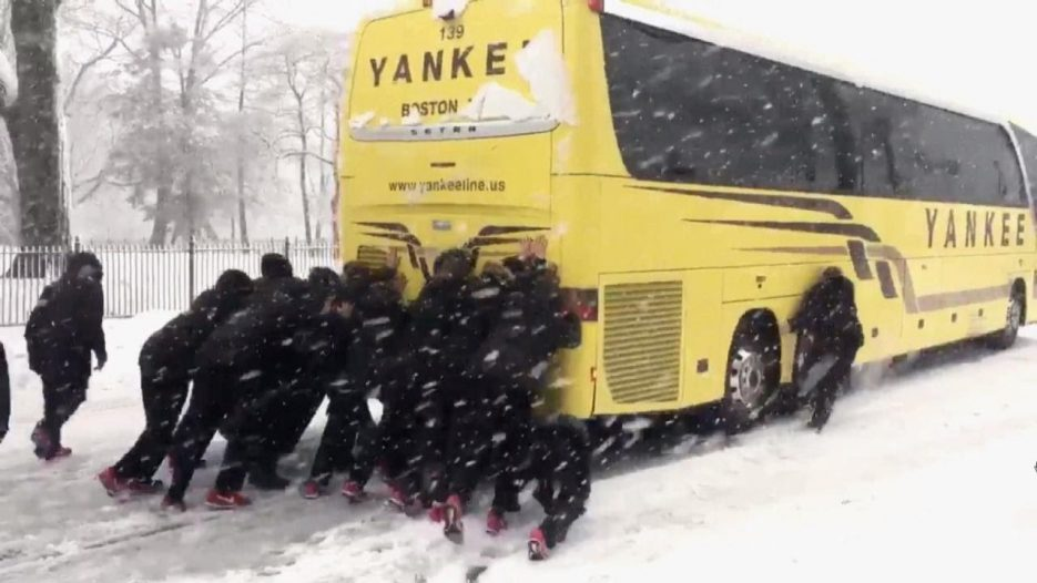 Northeastern University Woman's Basketball Team Pushes Bus Out of Snow