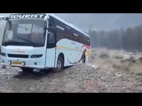 Manali heavy rains — Volvo bus taken by river Beas