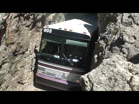 Charter Bus in Rock Tunnel